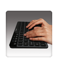 Hands typing on K810 keyboard