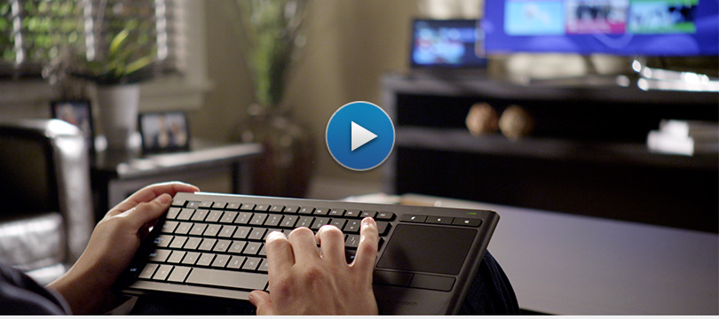 Product video image, man in living room holding keyboard