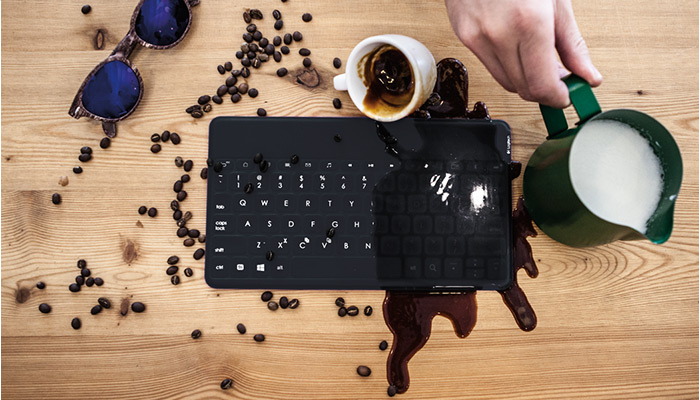 Coffee spilled on keyboard to show durability