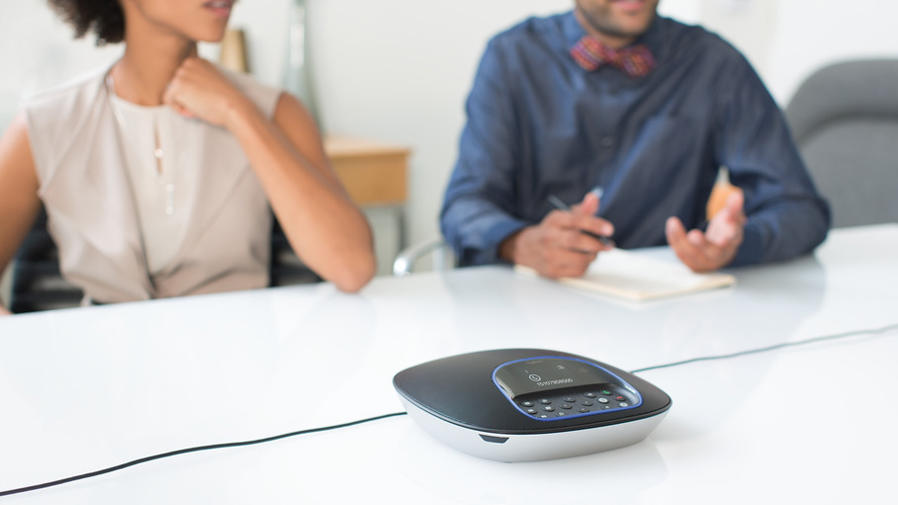 Logitech Group product sitting on conference room table