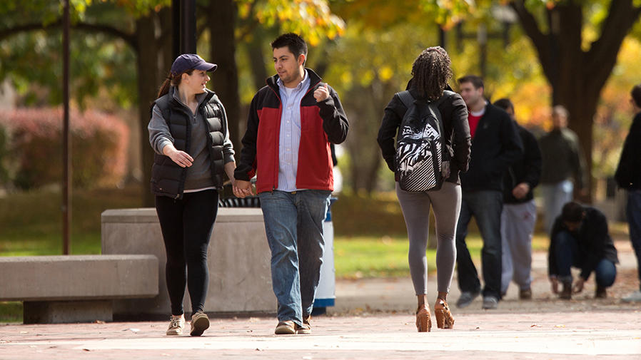 A couple walking together on campus