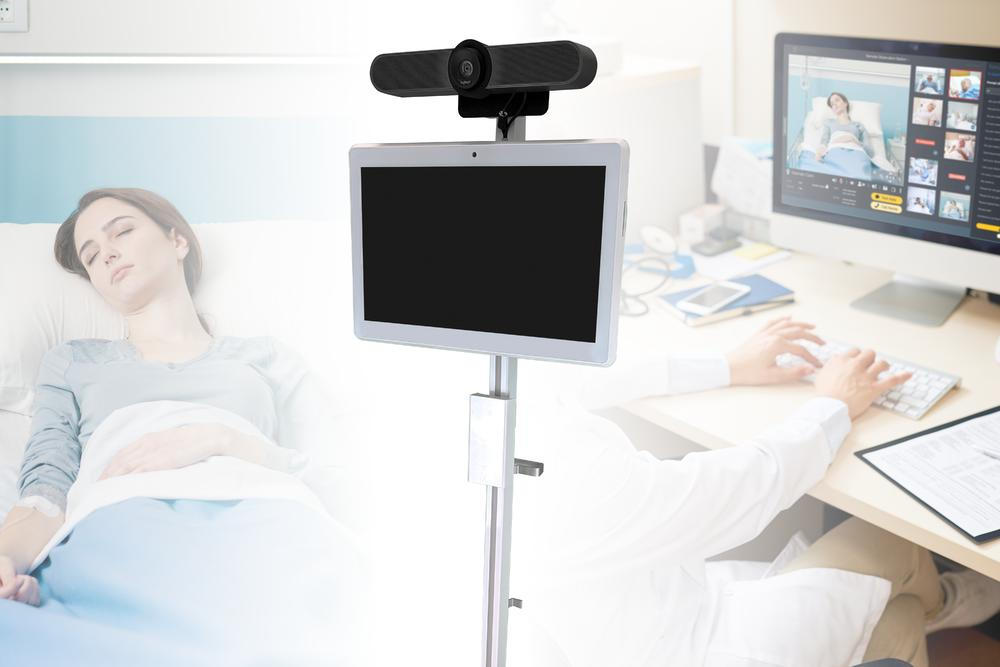 Logitech MeetUp and a medical-grade touch-screen display for conducting telehealth with patient