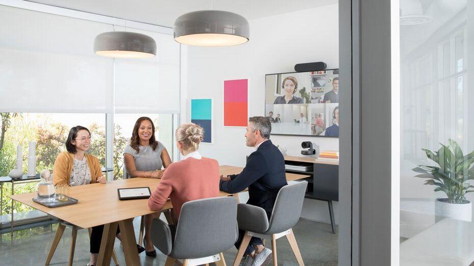 People in a conference room video conferencing with video conferencing equipments