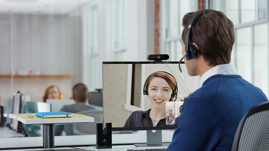 Man video conferencing at personal desk
