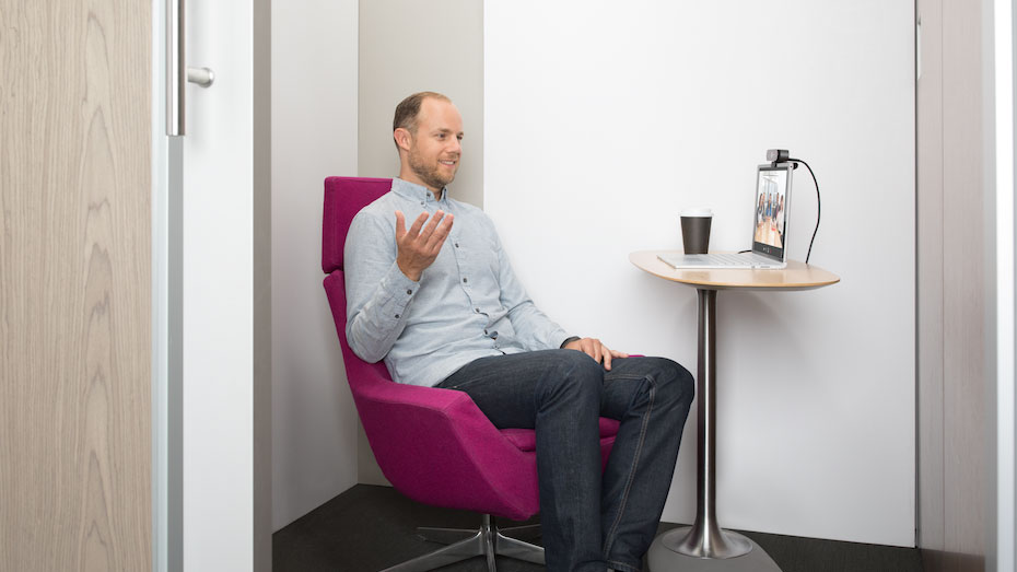 Man in videoconference in a booth